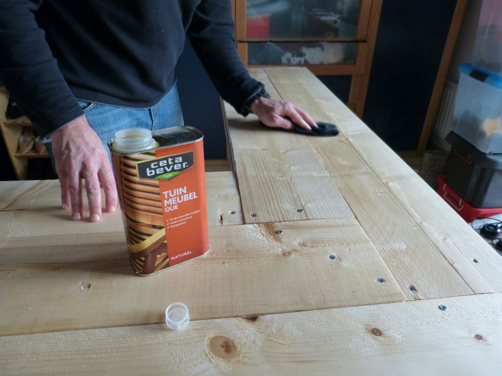 Using a an oil instead of a varnish. Applied with a towel to in three layers to darken and protect the wood.
